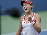Eugenie Bouchard of Canada reacts as she scores a point against to Polona Hercog of Slovenia during their 2015 US Open Women's Singles round 2 match at the USTA Billie Jean King National Tennis Center September 2, 2015