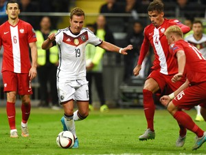 Poland´s Grzegorz Krychowiak and Germany's midfielder Mario Gotze vie for the ball during the Euro 2016 qualifying football match between Germany and Poland in Frankfurt am Main, central Germany, on September 4, 2015. Germany wins 3-1.