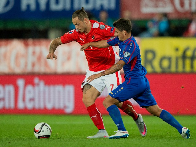 Austrian Marko Arnautovic (L) and Moldova's Gheorghe Andronic (R) vie for the ball during the Euro 2016 qualifying Group G football match between Austria and Moldova in Vienna on September 5, 2015.