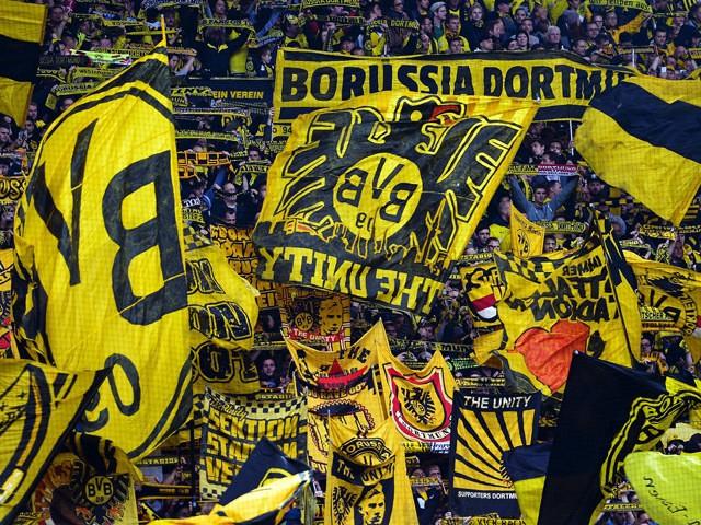 Dortmund's fans cheer their team during the German First division Bundesliga football match Borussia Dortmund vs Hannover 96 on October 25, 2014