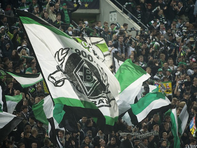 Gladbach fans wave flags during the UEFA Europa League Group C football match VfL Borussia Moenchengladbach vs Olympique de Marseille in Moenchengladbach, western Germany on October 25, 2012. Moenchengladbach defeated Marseille 2-0. AFP PHOTO / ODD ANDERS
