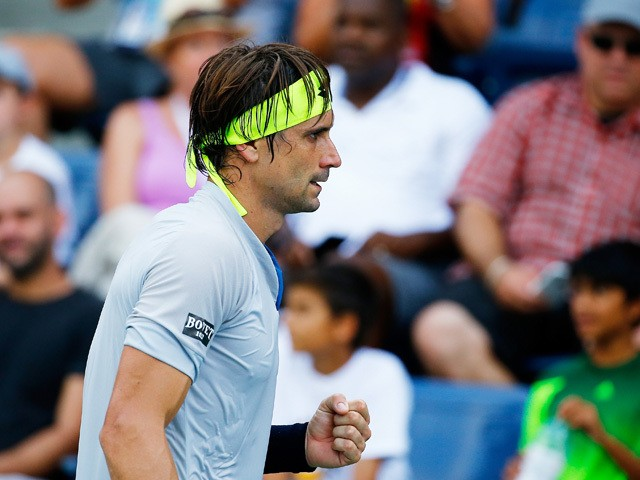 David Ferrer of Spain reacts against Radu Albot of Republic of Moldova during their Men's Singles First Round match on Day One of the 2015 US Open at the USTA Billie Jean King National Tennis Center on August 31, 2015