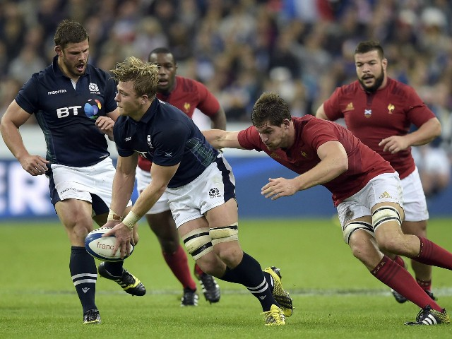 France's lock Alexandre Flanquart (R) tackles Scotland's number 8 David Denton (L) during the rugby union test match between France and Scotland at the Stade de France in Saint-Denis, north of Paris, on August 5, 2015.