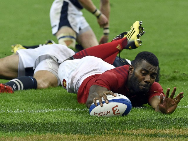 France's winger Noa Nakaitaci scores a try during the rugby union test match between France and Scotland at the Stade de France in Saint-Denis, north of Paris, on August 5, 2015.