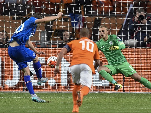 Iceland's midfielder Gylfi Sigurdsson shoots a penalty and scores during the UEFA Euro 2016 qualifying round football match between Netherlands and Iceland at the Arena Stadium, on September 3, 2015