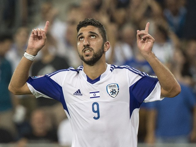 Israel's forward Munas Dabbur reacts following scoring a goal against Andorra's defender Ildefons Lima (R) during their Euro 2016 qualifying football match against Israel at the Sammy Ofer Stadium in the Israeli coastal city of Haifa on September 3, 2015