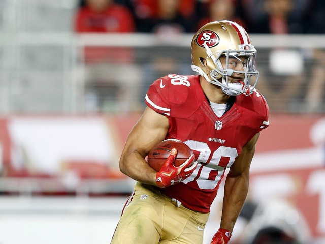 Jarryd Hayne #38 of the San Francisco 49ers returns a punt against the San Diego Chargers during their NFL preseason game at Levi's Stadium on September 3, 2015