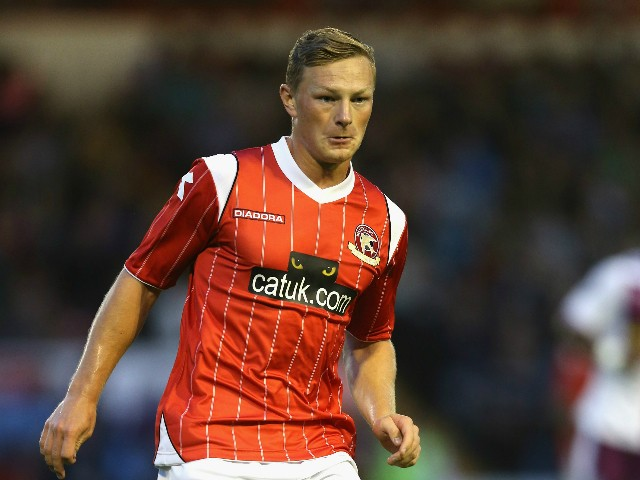 Sam Mantom of Walsall runs with the ball during the pre season friendly match between Walsall and Aston Villa at the Banks' Stadium on July 31, 2013 in Walsall, England.