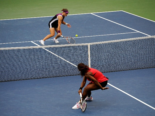 Samantha Stosur of Australia returns a shot against Serena Williams of the United States during the Women's Singles Final on Day Fourteen of the 2011 US Open at the USTA Billie Jean King National Tennis Center on September 11, 2011 in the Flushing neighbo