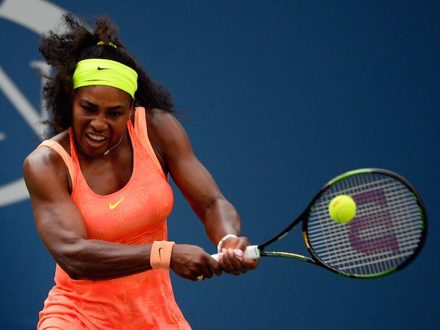 Serena Williams of the United States returns a shot to Kiki Bertens of the Netherlands during their Women's Singles Second Round match on Day Three of the 2015 US Open at the USTA Billie Jean King National Tennis Center on September 2, 2015 in the Flushin