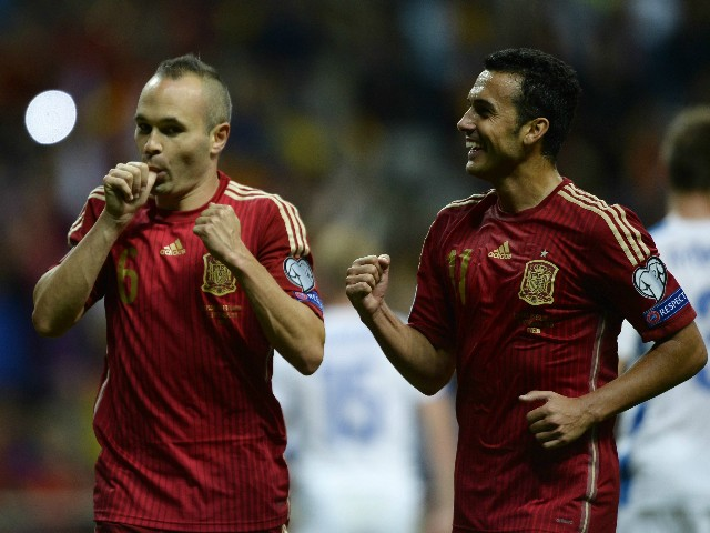 Spain's midfielder Andres Iniesta (L) celebrates with Spain's forward Pedro Rodriguez after scoring a goal during the Euro 2016 qualifying football match Spain vs Slovakia at the Carlos Tartiere stadium in Oviedo on September 5, 2015.