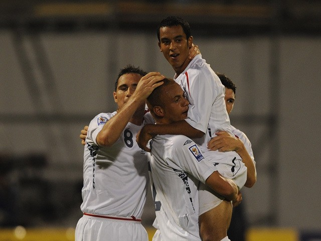Theo Walcott of England celebrates scoring his team's second goal with his team mates during the FIFA 2010 World Cup Qualifying Group Six match between Croatia and England at the Maksimir Stadium on September 10, 2008