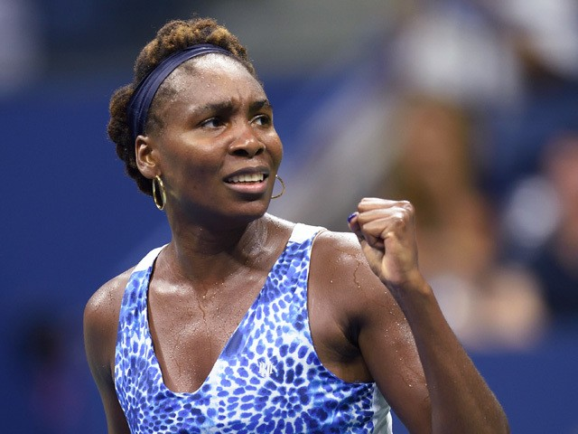 Venus Williams of the US celebrates during her victory over Irina ...