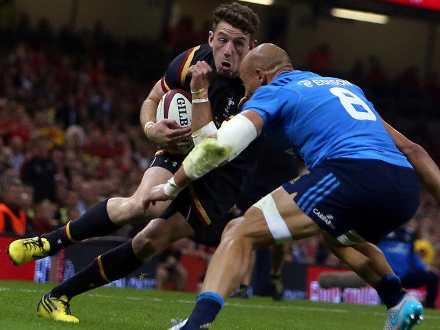 Wales' wing Alex Cuthbert (L) runs at the Italian captain Sergio Parisse (R) during the international rugby union friendly match between Wales and Italy, ahead of the 2015 Rugby World Cup, at The Millennium Stadium in Cardiff, south Wales, on September 5,