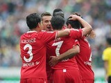 Artur Sobiech is congratulated by Hannover teammates after he scores the opener against Dortmund on September 12, 2015