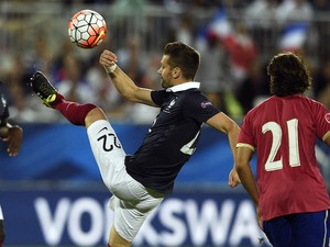 France's midfielder Morgan Schneiderlin (C) kicks the ball during the Euro 2016 friendly football match France vs Serbia at the Matmut Atlantique stadium in Bordeaux on September 7, 2015.
