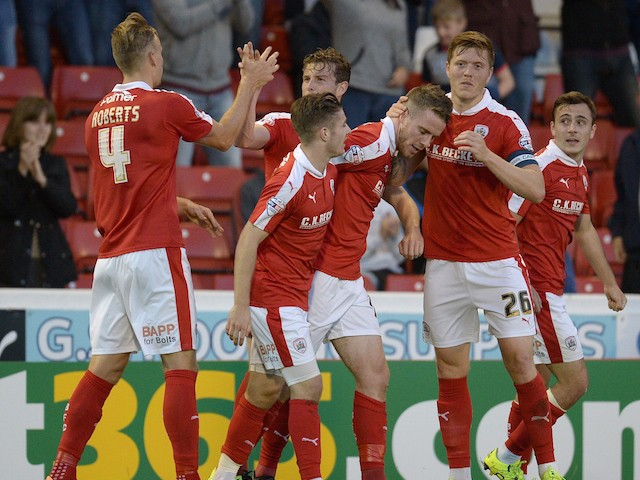 Barnsley's English midfielder Marley Watkins (3R) is congratulated by team mate Barnsley's English defender Alfie Mawson (2R) after scoring a goal during the English League Cup football match between Barnsley and Everton at the Oakwell Stadium in Barnsley
