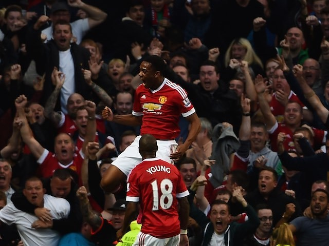 Anthony Martial celebrates scoring on his Man Utd debut against Liverpool on September 12, 2015