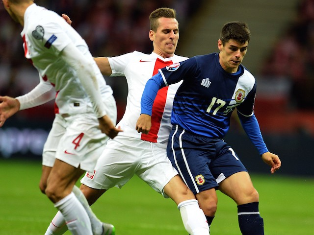 Gibraltar's Anthony Bardon (R) and Poland's Arkadiusz Milik vie for the ball during the UEFA Euro 2016 qualifying football match between Poland and Gibraltar, in Warsaw, Poland on September 7, 2015.