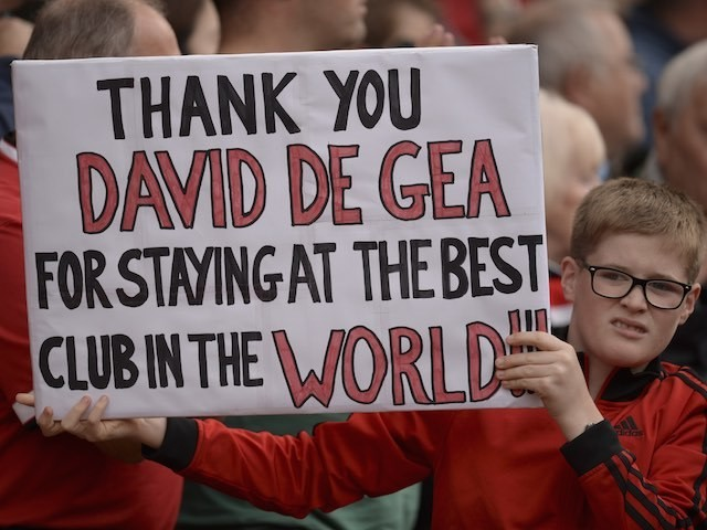 A young Manchester United fan looks slightly disgusted while showing his gratitude for David de Gea on September 12, 2015