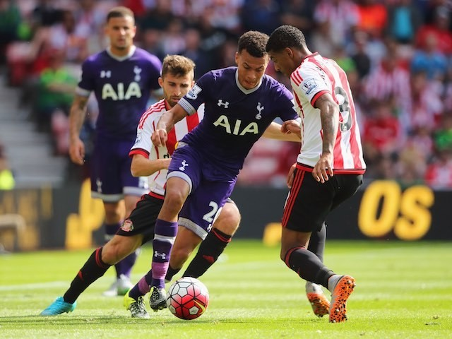 Del Alli is tagteamed by Fabio Borini and Patrick van Aanholt during the game between Sunderland and Spurs on September 13, 2015