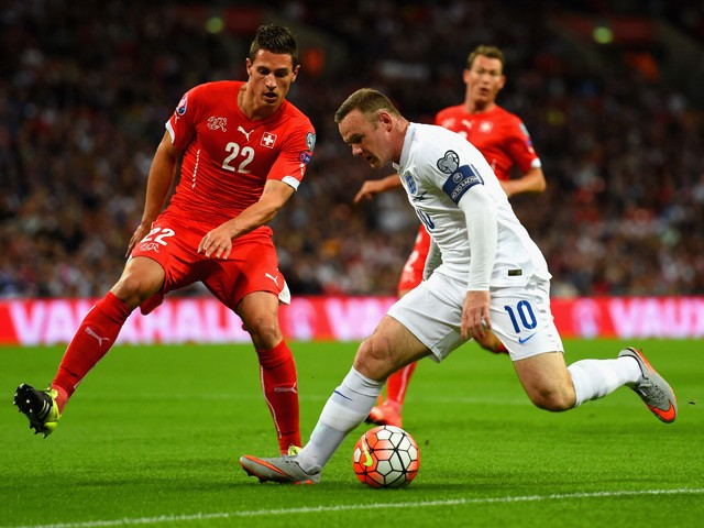 Wayne Rooney of England is marshalled by Fabian Schar of Switzerland during the UEFA EURO 2016 Group E qualifying match between England and Switzerland at Wembley Stadium on September 8, 2015