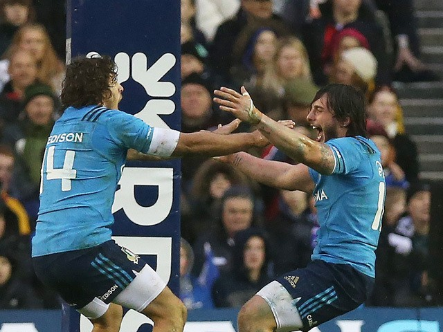 Italy's wing Michele Visentin (L) and Italy's centre Enrico Bacchin celebrate at full time in the Six Nations international rugby union match between Scotland and Italy at Murrayfield in Edinburgh, Scotland on February 28, 2015
