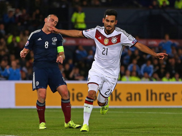 Germany's midfielder Ilkay Gundogan (R) celebrates after scoring their third goal as Scotland's midfielder Scott Brown reacts behind during the Euro 2016 qualifying group D football match between Scotland and Germany at Hampden Park in Glasgow on Septembe