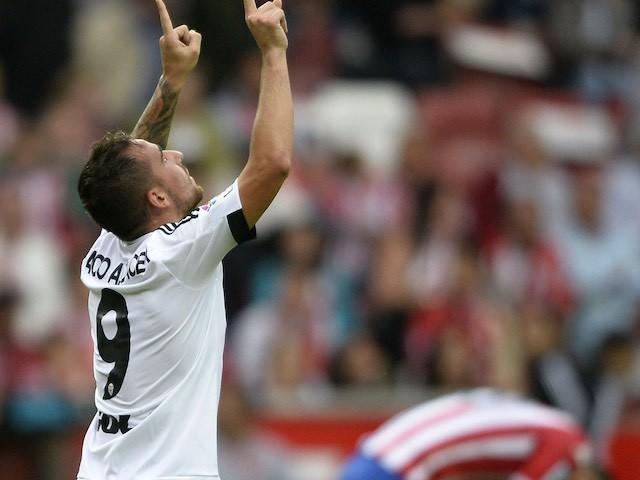 Paco Alcacer celebrates scoring for Valencia against Gijon on September 12, 2015