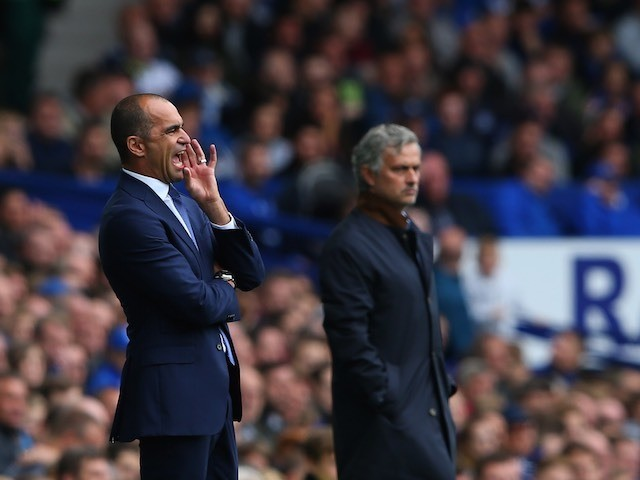 Everton boss Roberto Martinez and Chelsea counterpart Jose Mourinho stand on the touchline on September 12, 2015