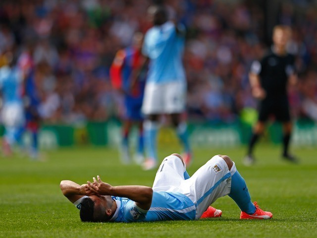 Man City striker Sergio Aguero lies injured during the game with Crystal Palace on September 12, 2015