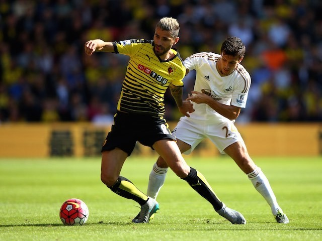 Watford's Valon Behrami is challenged by Jack Cork of Swansea on September 12, 2015