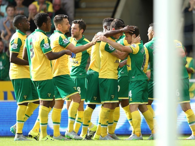 Wes Hoolahan is congratulated by teammates after scoring Norwich's second against Bournemouth on September 12, 2015