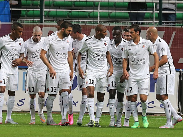 Caen players celebrate after Julien Feret grabs the opener against Troyes on September 12, 2015