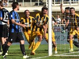 Eros Pisano of Hellas Verona celebrates after scoring the equalizing goal during the Serie A match between Atalanta BC and Hellas Verona FC at Stadio Atleti Azzurri d'Italia on September 20, 2015