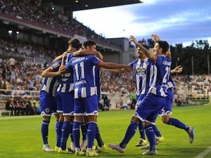 Juanfran celebrates with teammates after scoring for Deportivo La Coruna against Rayo Vallecano on September 14, 2015