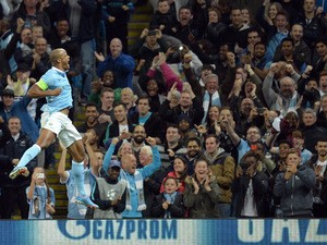 Manchester City's Belgian defender Vincent Kompany (L) celebrates an own goal by Juventus' defender from Italy Giorgio Chiellini during a UEFA Champions League group stage football match between Manchester City and Juventus at the Etihad stadium in Manche
