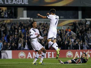 Tottenham Hotspur's South Korean striker Son Heung-Min (2nd R) celebrates scoring his second goal with Tottenham Hotspur's English midfielder Dele Alli (L) during the UEFA Europa League Group J football match between Tottenham Hotspur FC and Qarabag FK on