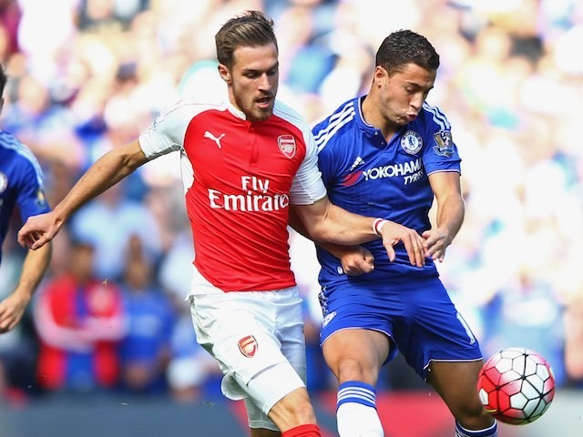 Aaron Ramsey and Eden Hazard tussle during the game between Chelsea and Arsenal on September 19, 2015