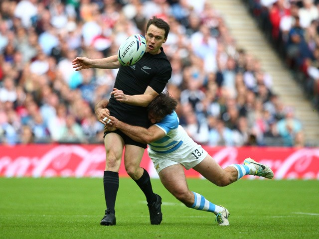 Marcelo Bosch of Argentina tackles Ben Smith of the New Zealand All Blacks during the 2015 Rugby World Cup Pool C match between New Zealand and Argentina at Wembley Stadium on September 20, 2015