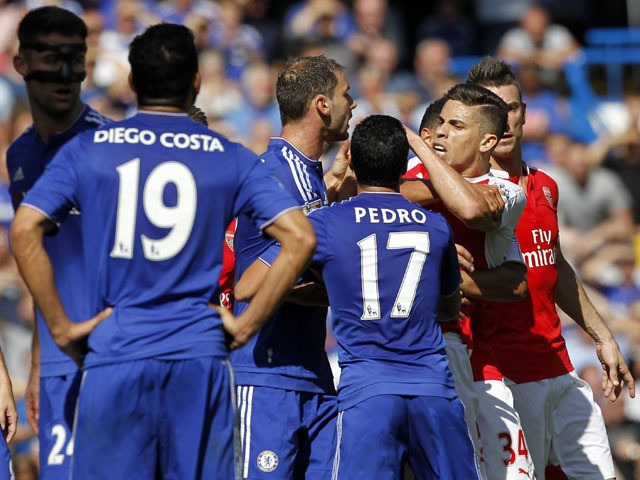 Arsenal's Brazilian defender Gabriel (2nd R) reacts after being sent off by referee Mike Dean (not pictured) during the English Premier League football match between Chelsea and Arsenal at Stamford Bridge in London on September 19, 2015