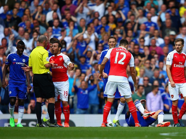 Santi Cazorla of Arsenal is shown a red card by referee Mike Dean during the Barclays Premier League match between Chelsea and Arsenal at Stamford Bridge on September 19, 2015