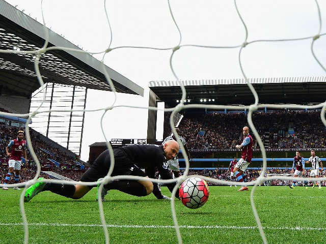 Saido Berahino (obscured) of West Bromwich Albion scores his team's first goal past Brad Guzan of Aston Villa during the Barclays Premier League match between Aston Villa and West Bromwich Albion at Villa Park on September 19, 2015 in Birmingham, United K