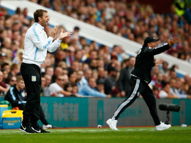 Tim Sherwood Manager of Aston Villa and Tony Pulis manager of West Bromwich Albion gesture during the Barclays Premier League match between Aston Villa and West Bromwich Albion at Villa Park on September 19, 2015 in Birmingham, United Kingdom.