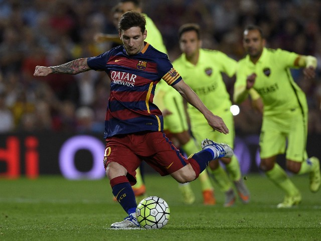 Barcelona's Argentinian forward Lionel Messi kicks to score on a penalty kick during the Spanish league football match FC Barcelona vs Levante UD at the Camp Nou stadium in Barcelona on September 20, 2015.