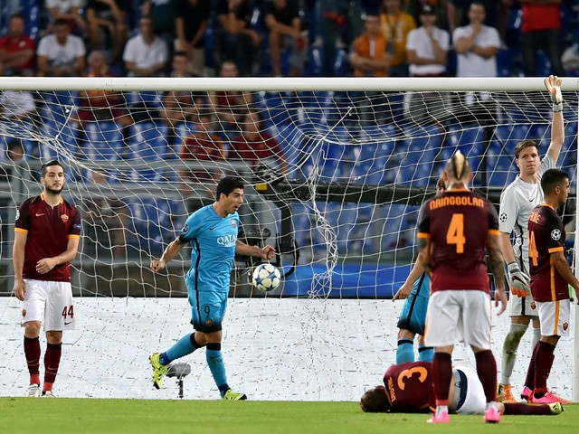 Barcelona's Uruguayan forward Luis Suarez celebrates after scoring against AS Roma during the UEFA Champions League football match between AS Roma and FC Barcelona at the Rome Olympic stadium, on September 16, 2015