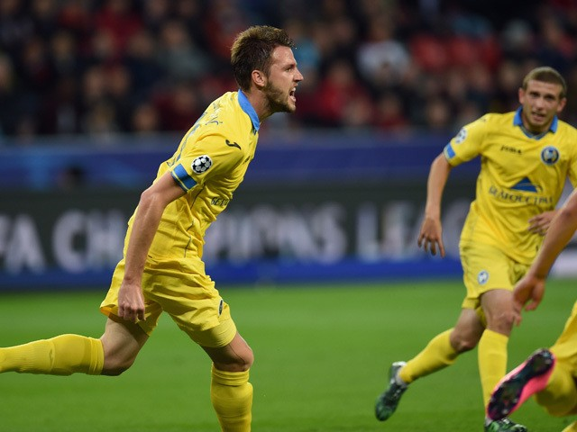 BATE Borisov's forward Dmitri Mozolevski (L) celebrates scoring with his team-mates during the UEFA Champions League group E first leg football match between Bayer 04 Leverkusen and FC Bate Borisov in Leverkusen, western Germany on September 16, 2015
