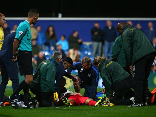 Tommy Spurr of Blackburn gets treatment after a head injury during the Sky Bet Championship match between Queens Park Rangers and Blackburn Rangers at Loftus Road on September 16, 2015