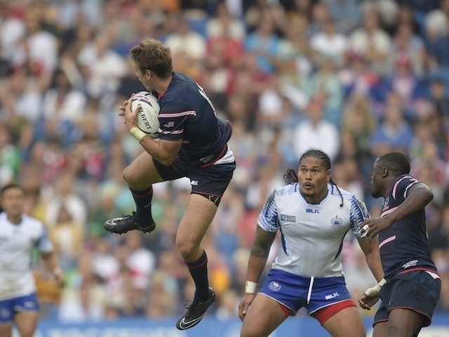 The USA's Blaine Scully jumps with the ball during the Rugby World Cup game with Samoa on September 20, 2015