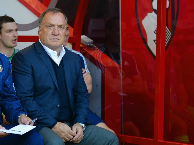 Dick Advocaat (1st R) manager of Sunderland looks on during the Barclays Premier League match between A.F.C. Bournemouth and Sunderland at Vitality Stadium on September 19, 2015 in Bournemouth, United Kingdom.